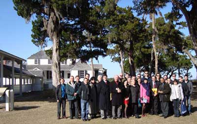 Photo of French delegation in front of owner's home at Kingsley Plantation
