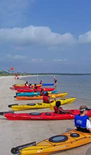 Timucuan Explorers in their kayaks on the beach