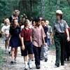 Elementary school students on a walk with a park ranger at Fort Caroline