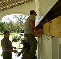 Preservation staff replace sill beams in historic building at Kingsley Plantation.