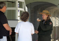 Ranger with two visitors during a program.