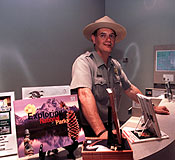 Park ranger at the visitor center desk.