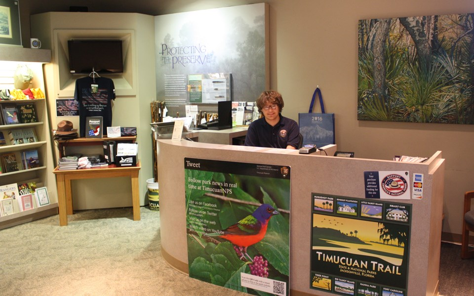 volunteer working at front desk