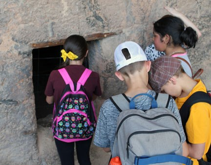 Students exploring the Lower Cliff Dwelling