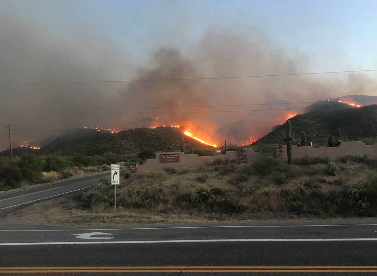 Entrance of Tonto NM with hills on fire