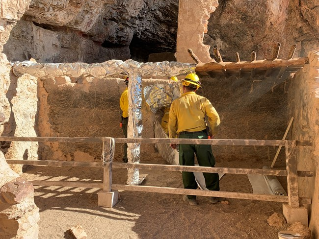 Cliff Dwelling being wrapped to prepare for wildfire