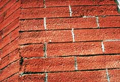 Scarred and pitted brick.