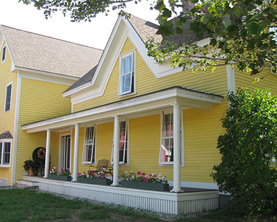 Yellow Farmhouse With Center Gable And Front Porch. Farmhouse With Energy  Efficient ... Images