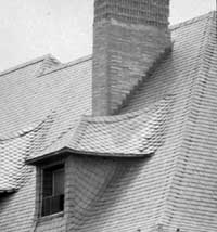 Slate Roof And Sided Roofed Dormer