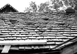Rustic Split Faced Shingles On A Roof.