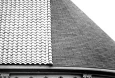 Clay Tiles, On The Left, And Asphalt Shingles, On The Right, On