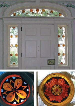 Clear And Stained Glass In An Arched Transom And In Sidelights Flanking A  Paneled Door.