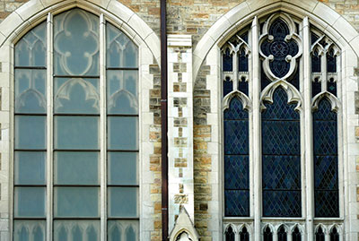 Exterior Protective Glazing That Obscures The Details Of A Neo Gothic Style Church Window On