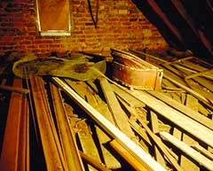 Molding and other lengths of wood piled in an attic. Photo: Travis C. McDonald, Jr.