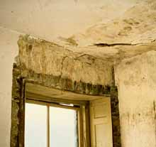 Cracked And Bubbled Plaster On Walls And Ceiling Around A Window With A  Paneled Reveal.