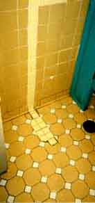 Ceramic Tile Wall And Floor Repaired With A Wide Strip Of Caulk
