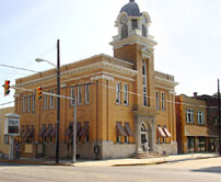 Charming County Courthouse With Awnings Shading The First Floor Windows.