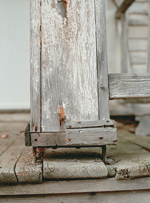 Close Up Of A Porch Post On Metal Foot Elevating It Above The