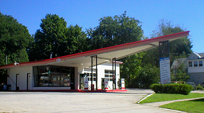 Gas station with triangular canopy extending from the building. & Preservation Brief 46: The Preservation and Reuse of Historic Gas ...