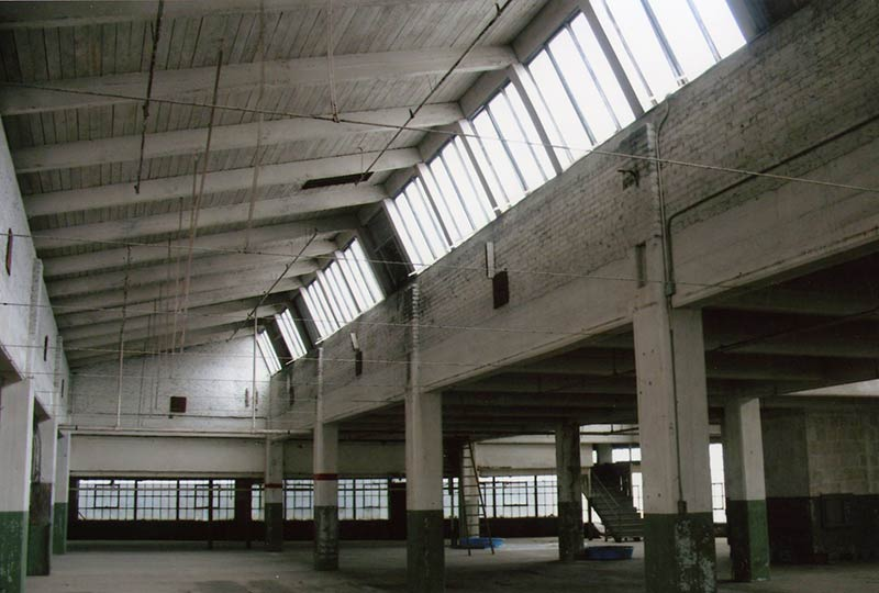 Interior Of An Industrial Building With Exposed Wood Structure And  Clerestory Windows, Before Rehabilitation.