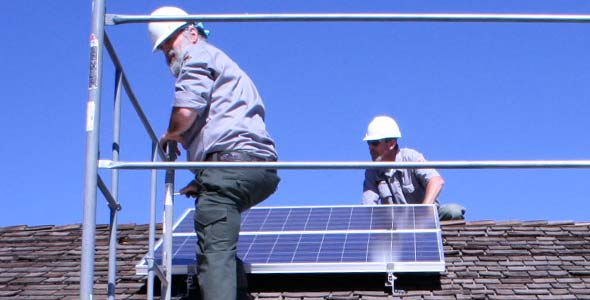 NPS Employees Installing Solar Panels On A Pavilion Roof.