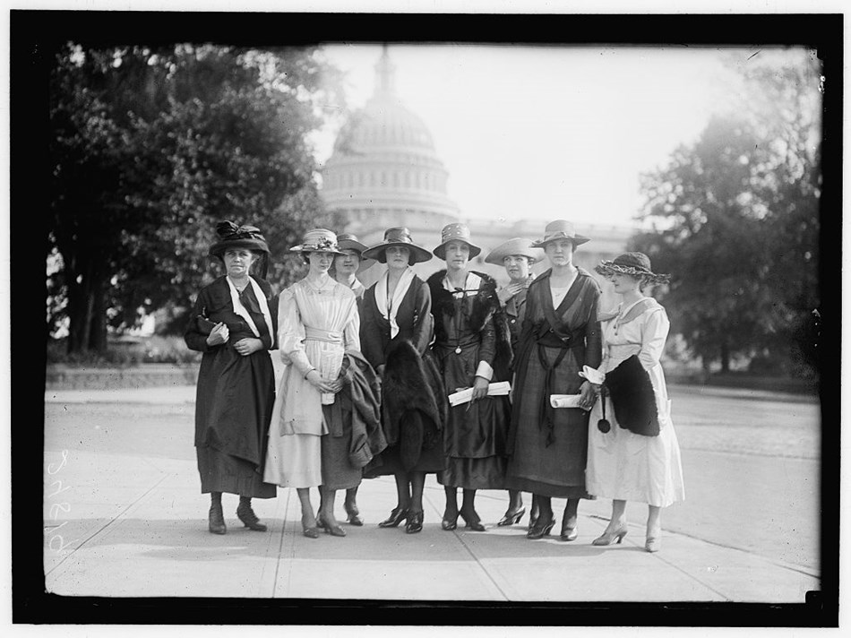 A group of women pose in front of the Capitol dome, circa 1918.