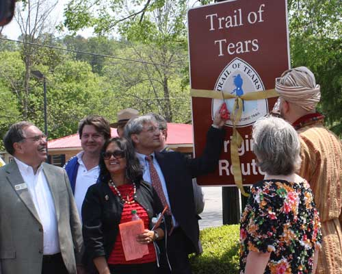 Cherokee Chief Dan Smith performs the ribbon cutting at an Original Route signage unveiling on the Trail of Tears National Historic Trail.