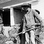 Civilian Conservation Corps (CCC) members build rock walls around the Fish and Wilife Visitor Center.
