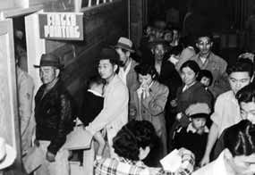 Japanese Americans wait to be Finger Printed in route to Tule Lake Segregation Center