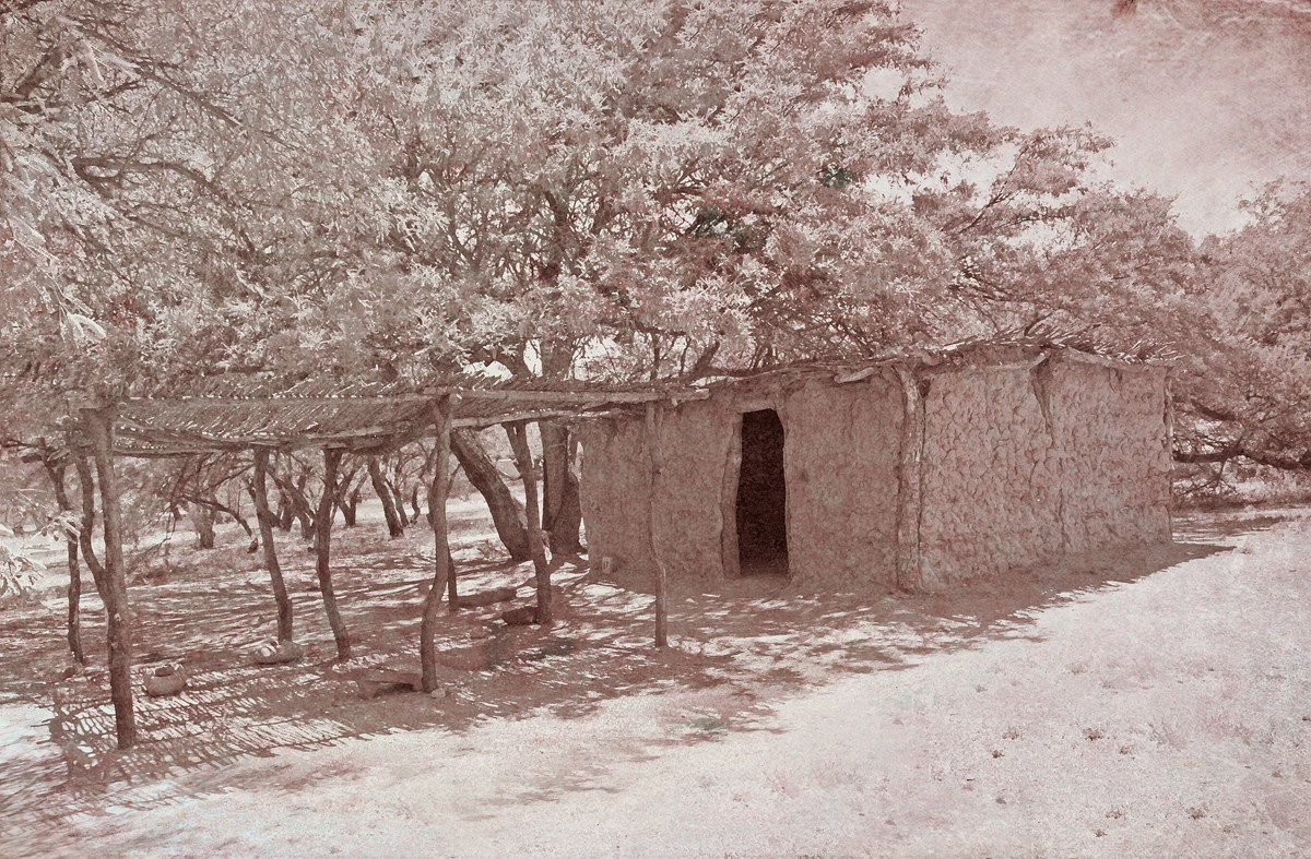 Sepia tone image of mud house.