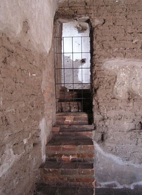 steps leading to gated doorway