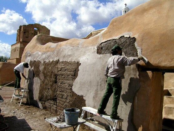 Lime plastering the granary