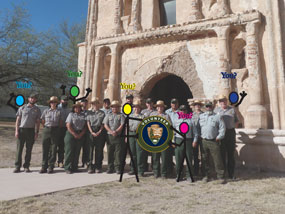 NPS staff and volunteers rendered as stick figures in front of church