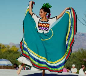 colorful folklorico dancer holding skirt