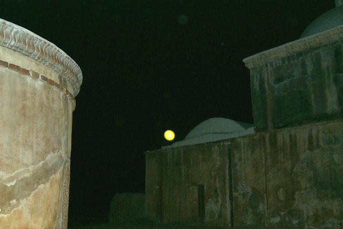 Full Moon in sky over sacristy dome with mortuary chapel in foreground