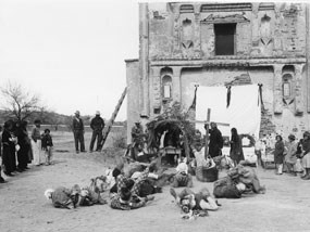 historical passion play in front of tumacacori mission church, people laying on ground in front of bower
