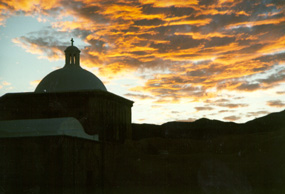 Early morning light on clouds over the mission church