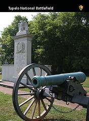 a cannon and monument on the front of a trading card
