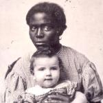 Enslaved woman with white child.