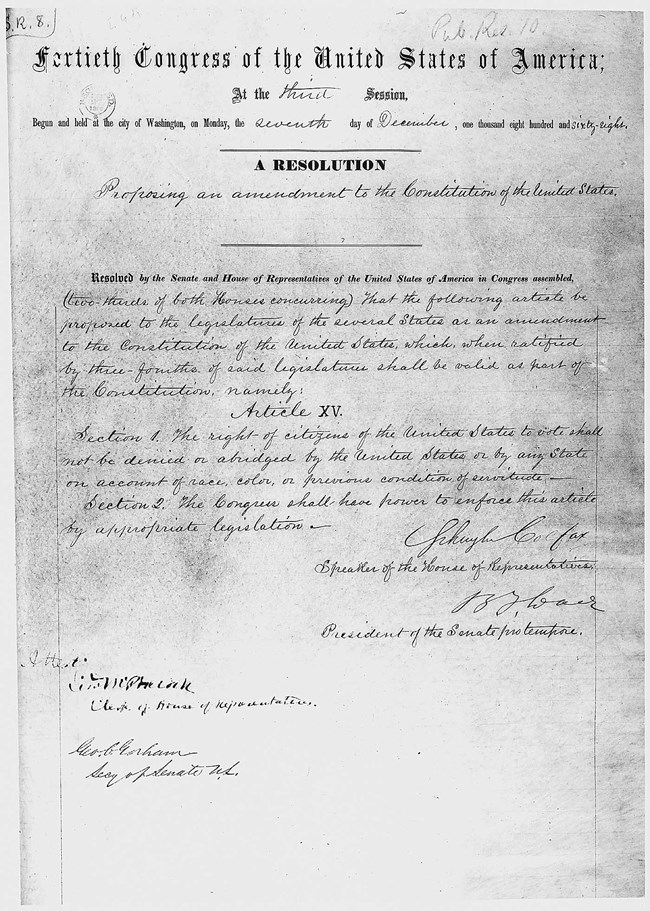 Black and white copy of the original Fifteenth Amendment to the U.S. Constitution in cursive handwriting.