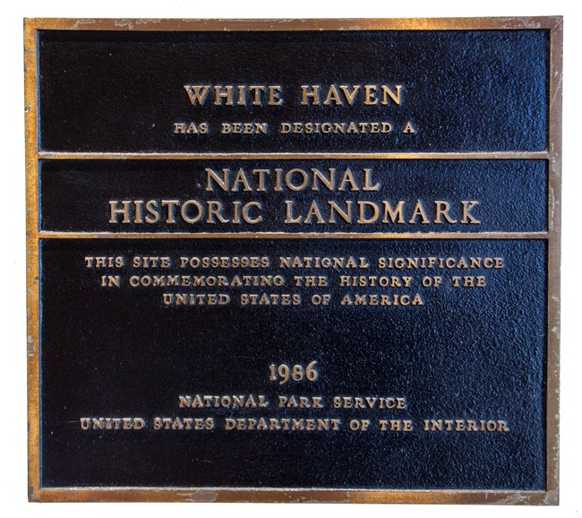 Photograph of a bronze plaque designating White Haven and a National Historic Landmark