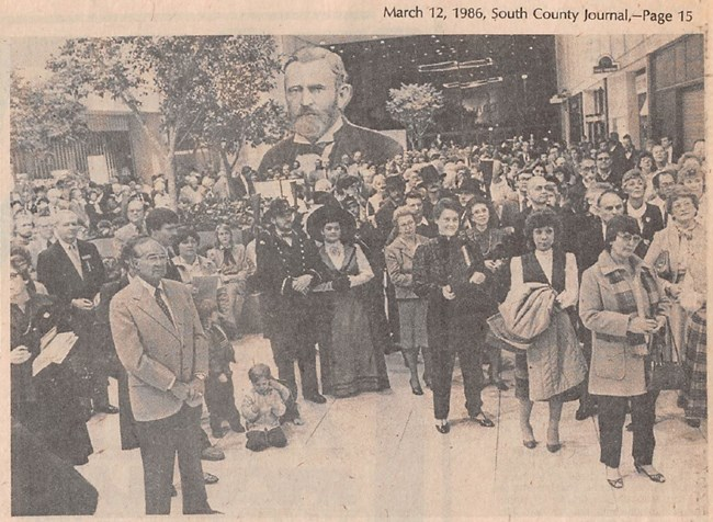 Black and white photograph of a large crowd of people in Crestwood Mall, some dressed as Ulysses and Julia Grant