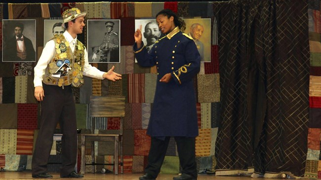 Lift Every Voice play with two actors on stage, one dressed as a Junior Ranger