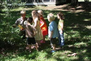 Children exploring nature during the River Reading program.