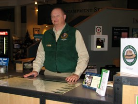 volunteer randy rice at welcome center desk