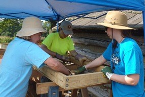 Volunteers screening for artifacts at the 2013 excavation site