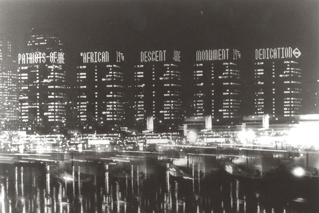 black and white photograph, buildings, lights, river, philadelphia