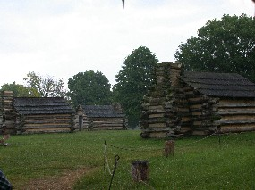 Rain falls onto huts built at the location of Muhlenberg's brigade.