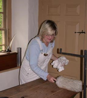 Volunteer assisting curatorial department with historic cleaning.