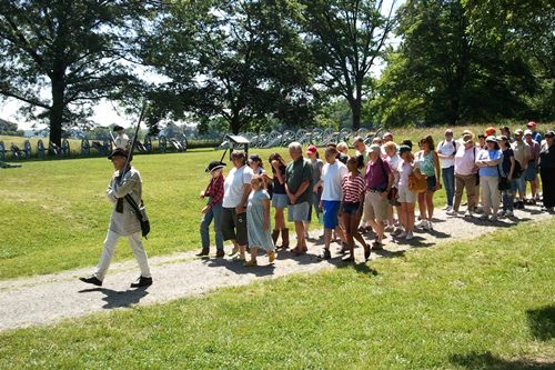 Soldier and visitors marching out of Valley Forge